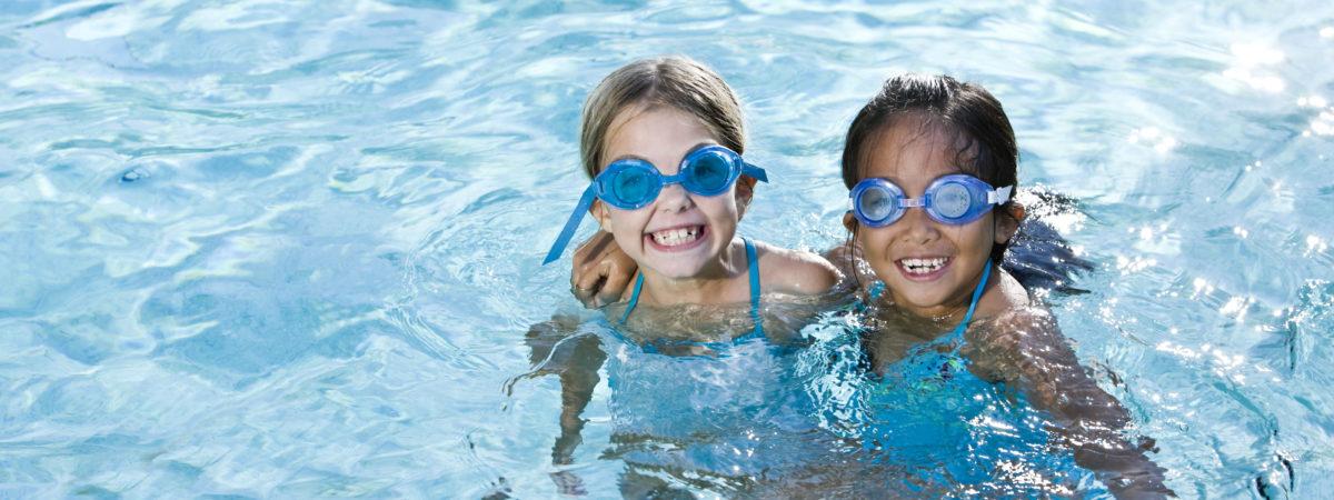 girls smiling in swimming pool
