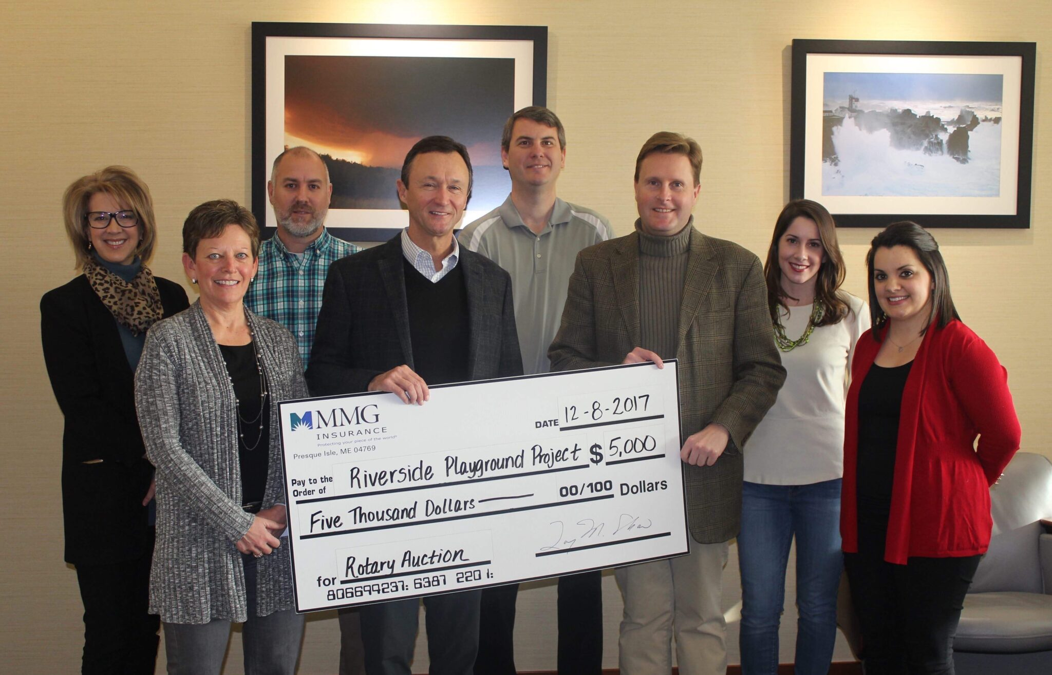 Photo of MMG donation to Riverside Park Community Playground Project