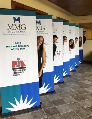 interns MMG hiding behind banners