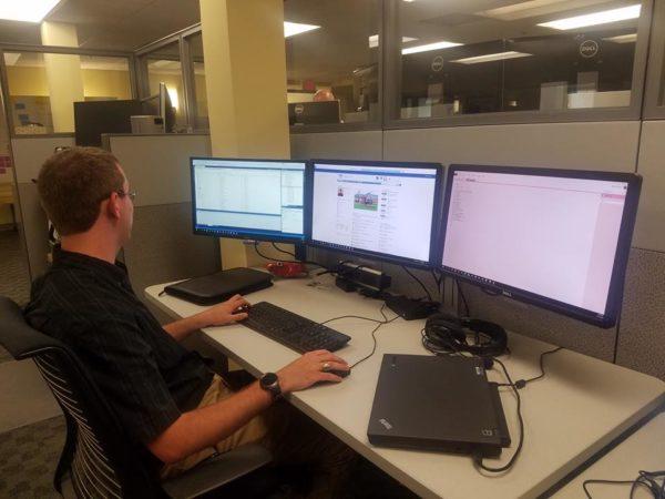 MMG intern using computer