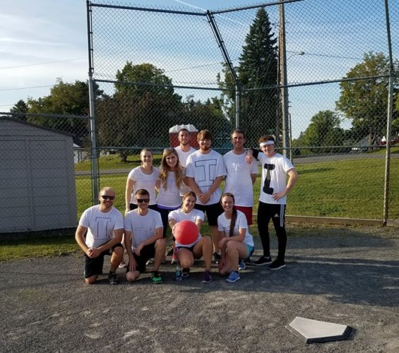 MMG interns posing for kickball picture